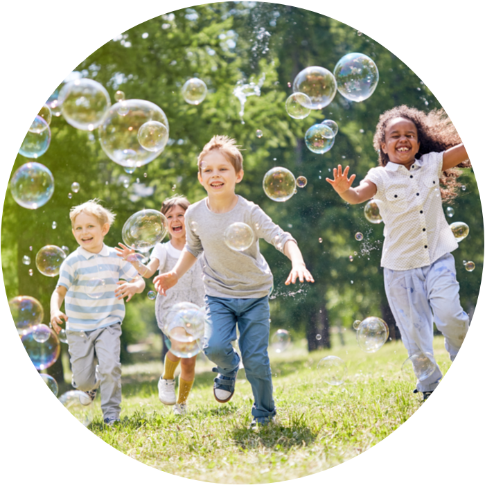 Kids running with bubbles